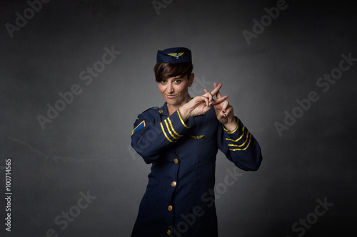 Air Hostess Gesturing Hashtag Symbol Buy This Stock Photo And