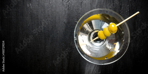 Foto op Aluminium Bar Martini with olives on a black table. Free space for text.
