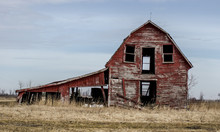 Death Of The Family Farm. Abandoned Structure Surrounded By Farm Fields Are A Testimony To The Economical Perils Of America's Farmer.