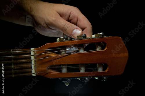 Fotografering  guitar tuning close up