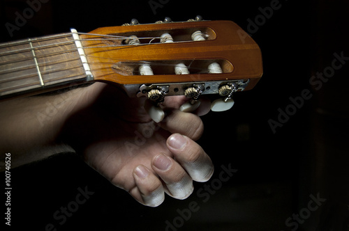 Fotografie, Tablou  guitar tuning close up