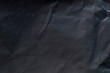 Leinwanddruck Bild - Dark crumpled paper
