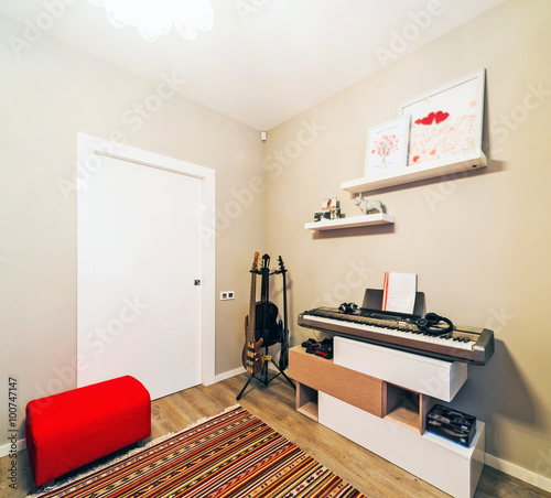 Urban apartment with red furniture and guitar - Buy this ...