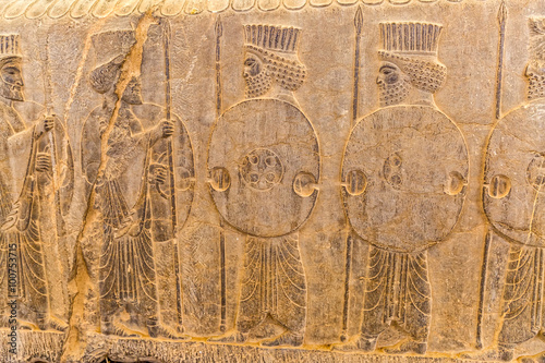 Guardians also known as the Immortals holding a spear, relief detail on the stairway facade of the Apadana at the old city Persepolis Poster