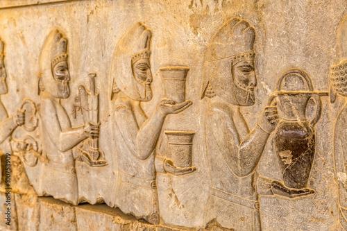 Foto op Plexiglas Artistiek mon. Armenian tribute relief detail on the stairway facade of the Apadana at the old city Persepolis.