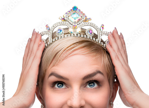 Fotografie, Obraz  Beauty queen pageant winner placing tiara on head celebrating individuality inde