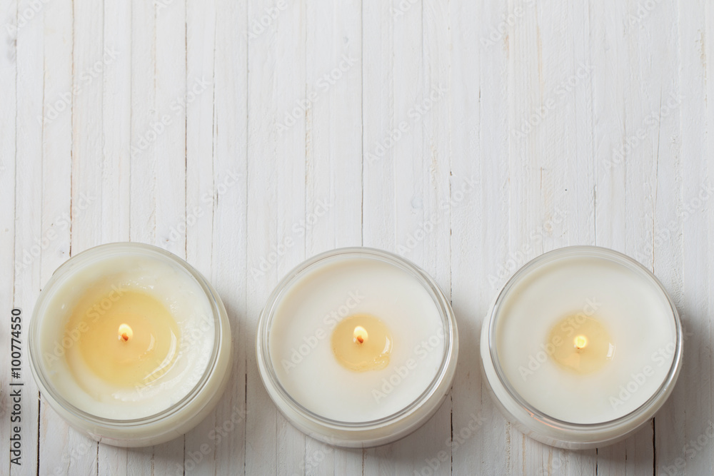 Fototapety, obrazy: scented candles on white wooden background
