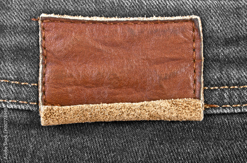 Fotobehang Stof Leather jeans label sewed on jeans
