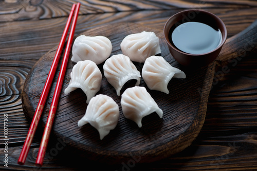 Close-up of chinese dim-sum dumplings served with a soy sauce Принти на полотні