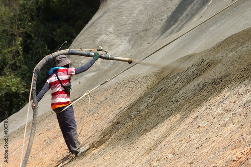 Photo Spraying Cement into the mountains In order to prevent collapse