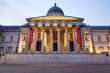 The National Gallery facade illuminated at dusk in London