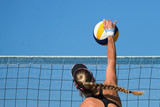 Female athletes playing beach volleyball