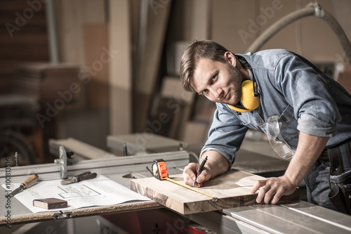 Smiling craftsman during his work Canvas Print