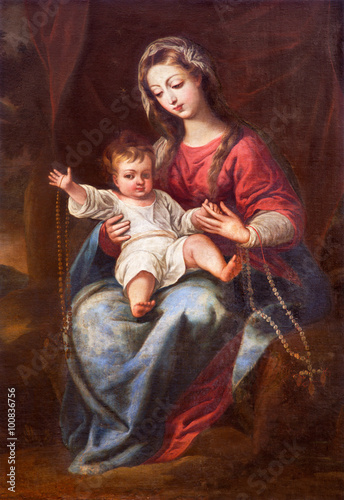 GRANADA, SPAIN - MAY 31, 2015: The Madonna (The Virgin of the Rosary) painting in church Monasterio de la Cartuja by unknown artist of 18. cent. - 100836756