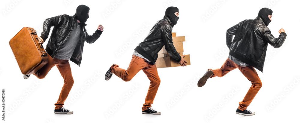 Fototapeta Robber holding boxes