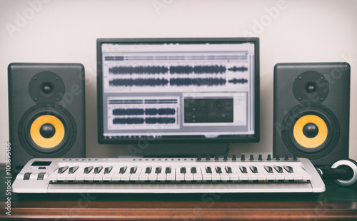 Photo  Home recording studio with professional monitors and midi keyboard