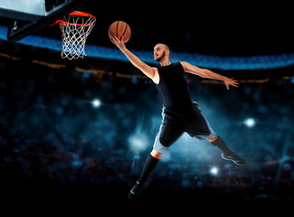 Fototapeta Koszykówka Photo of basketball player makes layup in the game
