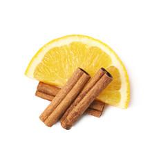 Orange Slice And Cinnamon Isolated