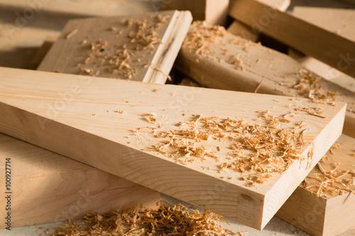 Obraz Wooden sticks lie on a workbench in the carpentry workshop - fototapety do salonu