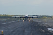 Front view on runway with taking off jet airplane