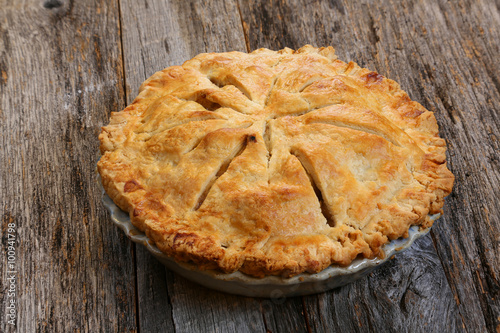 Delicious whole fresh baked rustic Apple Pie with table setting Canvas Print