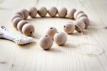 Wooden Beads On A Wooden Backg...