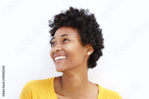 Fotografiet  Happy young african woman looking away