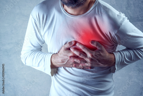Foto Severe heartache, man suffering from chest pain, having painful