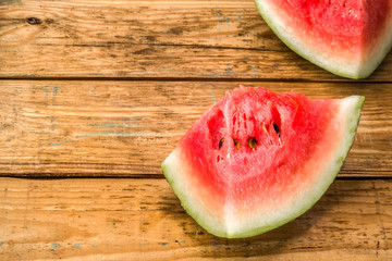 Slices of watermelon, background. Summer fruit on wooden planks