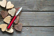 Carved Wooden Hearts And Knife Abstract Of Love