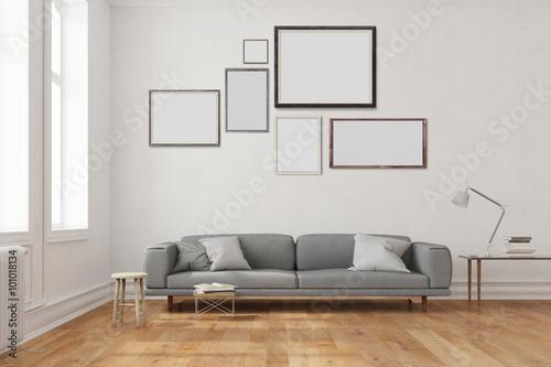 Viele leere Rahmen an Wand über Sofa