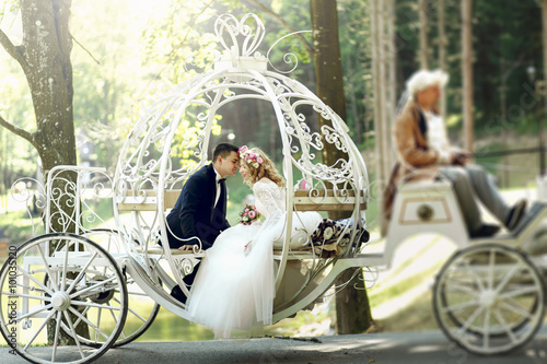 Fotografie, Obraz  Handsome groom kissing blonde beautiful bride in magical fairy t