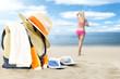 summer bag and woman on sand