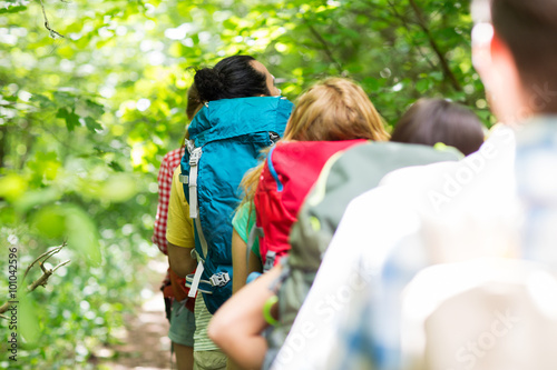 Foto op Aluminium Afrika close up of friends with backpacks hiking