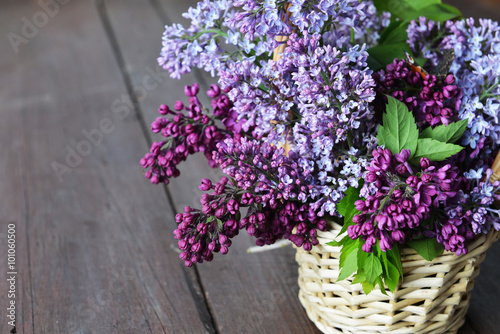 Foto op Canvas Lilac basket with branch of lilac