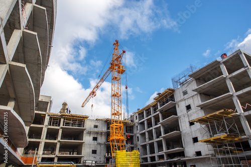 Crane construction bricks concrete building in city