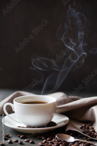 Fototapety, obrazy: Coffee cup and saucer on a wooden table. Grey background