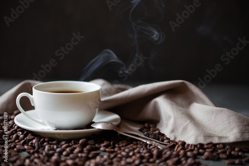 Wall Murals Cafe Coffee cup and saucer on a wooden table. Grey background