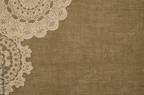 Crochet doily on linen background Tapéta, Fotótapéta