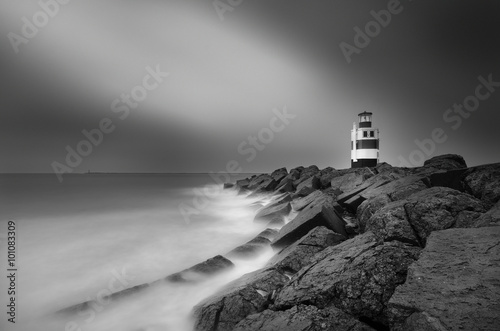 Fotografie, Obraz  Black and white picture and long exposure of the lighthouse in Ijmuiden