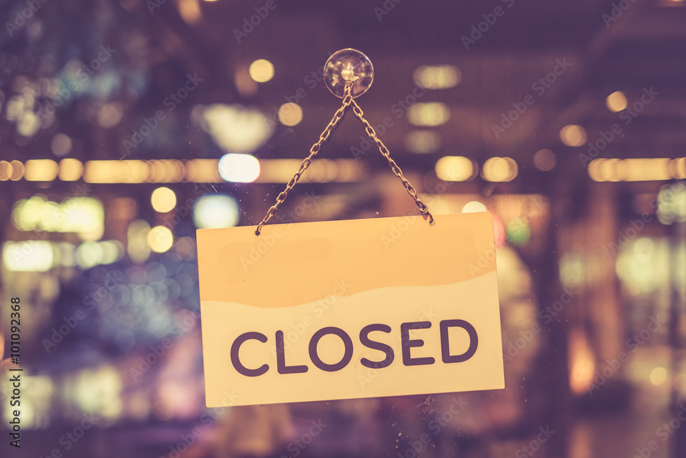 Fototapeta Vintage tone of :A closed sign hanging in a shop window