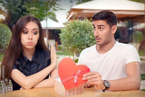 Girl Refusing Heart Shaped Gift From Her Boyfriend Canvas Print