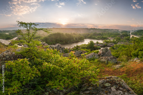 Morning landscape rising above the river mist sun