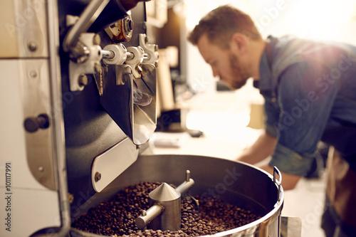 Fotografie, Obraz  Freshly roasted coffee beans in a modern machine