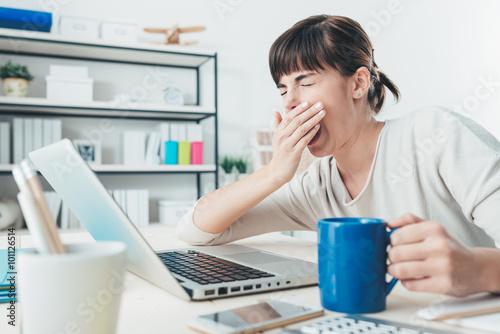 Fotografie, Obraz  Tired woman at office desk