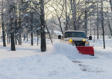 Snow Plow Doing Snow Removal A...