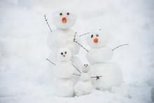 Funny Snowman Family On The Snow.