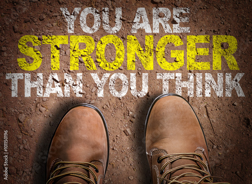 Photo  Top View of Boot on the trail with the text: You Are Stronger Than You Think