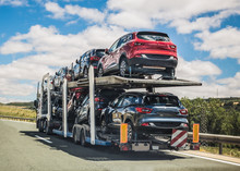 Car Transporter Moving On A Ro...