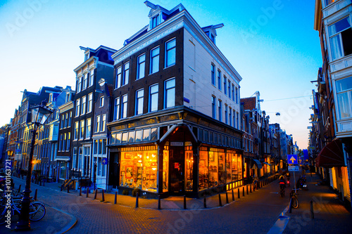 Traditional dutch medieval houses in Amsterdam at evening, Netherlands Canvas Print